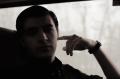 film photograph portrait young man train window silhouette chiaroscuro watch
