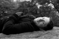 film photograph portrait young man black and white lying down