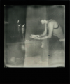 polaroid retro vintage cracked black and white young man boy sitting ritual candles reading prayer