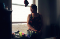 film photograph portrait young woman bokeh dreamy window chiaroscuro sitting