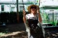 film photograph portrait young woman bokeh dreamy playground swing sunglasses