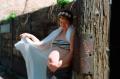 film photograph portrait young woman bokeh dreamy bellydance veil silk white flower crown crop top maternity