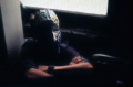 surrealist bokeh film photograph basement dark shadowy portrait boy young man mask creepy