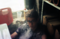 bokeh film photograph portrait young man smoke vape cloud