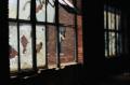 film photograph abandoned building urbex broken window panes glass