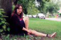 film photograph portrait young woman sitting outside tree ground