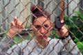 film photograph portrait young woman chain link fence lock