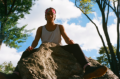 film photography portrait autumn young man sitting on rock