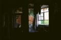 film photography urbex abandoned ruinporn crumbling debris king's park asylum chiaroscuro shadows silhouette crumbling room tatters