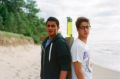 film photography portrait beach two young men back to back