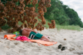 film photography portrait summer beach man lying towel