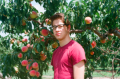 film photography portrait summer portrait young man peach tree