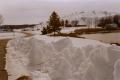 film photograph snow winter chunks clumps road evergreen tree ski slopes