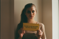 film photograph portrait young woman long hair blonde bokeh please allow 48 hours for full recovery sign holding