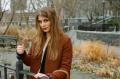 film photograph portrait young woman long hair blonde bokeh park
