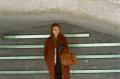 film photograph portrait young woman long hair blonde bokeh irish hunger memorial low ceiling standing leather handbag gloves