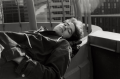 film photograph portrait young man lying down black and white sunlight hapa