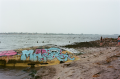 film photograph boat rowboat overturned graffiti octopus beach dead horse bay jamaica NYC new york sand