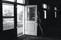 film photograph urbex abandoned black and white portrait door