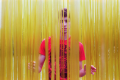 film photograph portrait young man boy yellow threads ropes strands curtain parting modern art sculpture