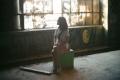 film photograph young woman girl sitting abandoned building broken window urbex exploring