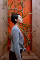 digital photograph portrait model plants conservatory hothouse leaves girl young woman standing orchids profile fashion side view asian sweater short hair pixie cut