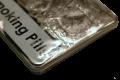 """small metal tin with """"smoking pills"""" on the lid"""
