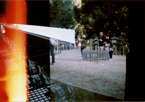 film photograph lomography temple graveyard Japan dark chiaroscuro effect composition surreal ray red flash blur ablution lanterns