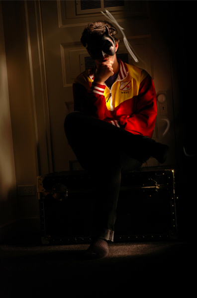 light portrait photography digital dark blur white WRFC jacket young man brunette sitting pensive diabolical devil mask chuck bass masked mysterious chiaroscuro