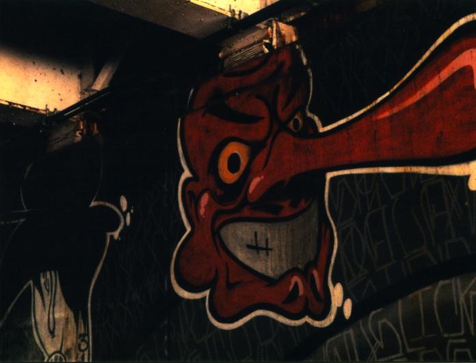 graffiti street art wall tengu japanese geisha red evil yellow eyes grinning mask