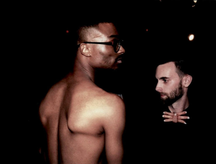 lomography lomo film photograph two young men naked shirtless torso shoulderblades glasses sculpted african american dark shadowy black staring profiles bowtie severed plastic fingers surreal funny creepy halloween chic hipster dressy