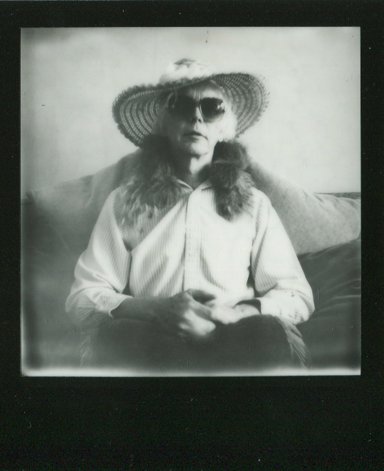 polaroid retro vintage black and white film impossible project border sun hat straw fur collar portrait