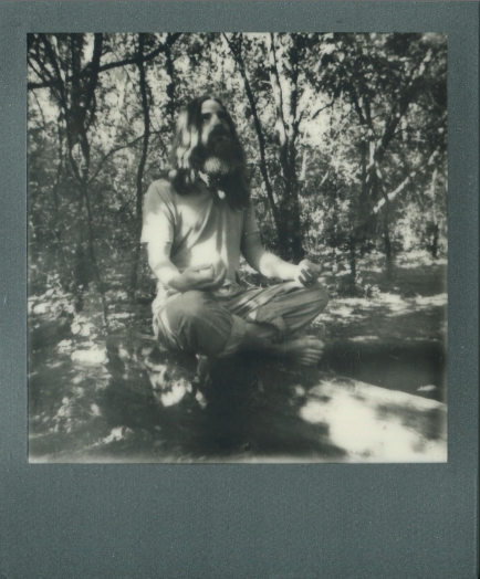 young man long hair red flowing beard hippie polaroid black and white sitting meditating crosslegged lotus