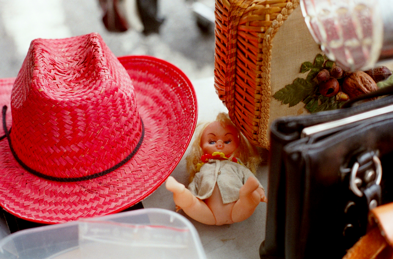 film photo vintage flea market antique doll baby naked creepy grimace red sun straw hat funny