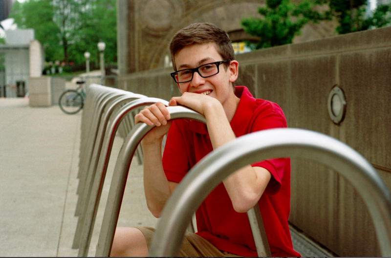 film photograph portrait boy red polo shirt glasses bicycle rack