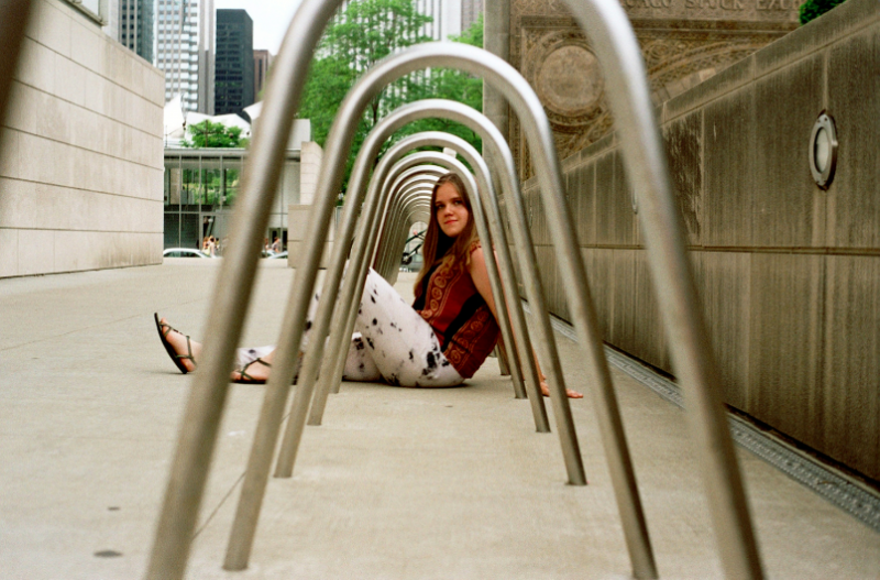 film photograph portrait girl sitting bicycle rack tunnel perspective
