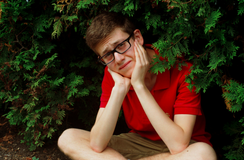 film photograph portrait evergreen boy glasses sitting pensive