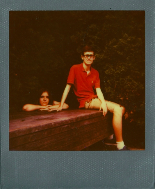 polaroid retro vintage color bench forest evergreen park boy girl sitting lurking