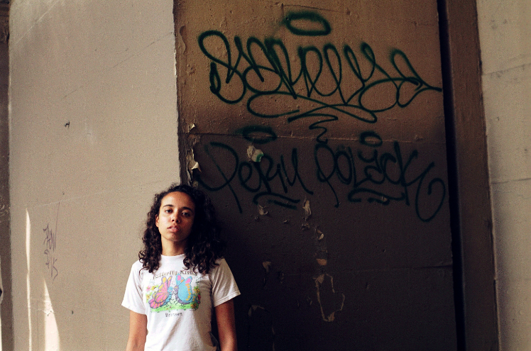 film photograph portrait young woman graffii wall