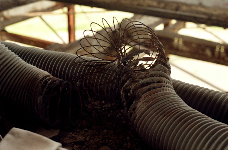 film photograph urbex factory abandoned coil tubing slinky spring debris
