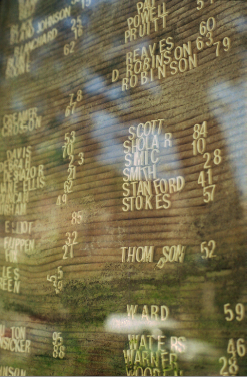 film photograph reflection glass apartment name listing old  directory