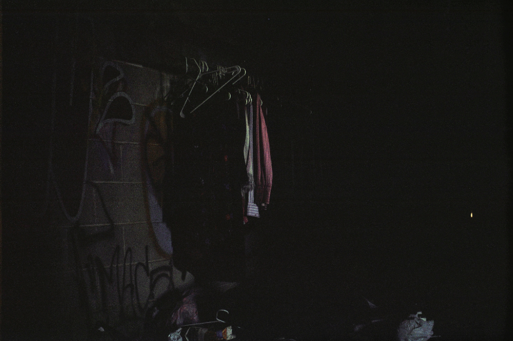 abandoned building graffiti clothing hangers