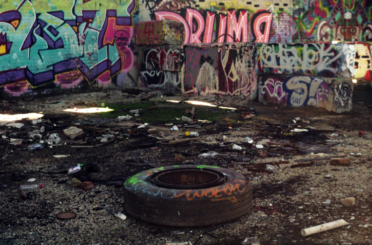 abandoned building graffiti tire