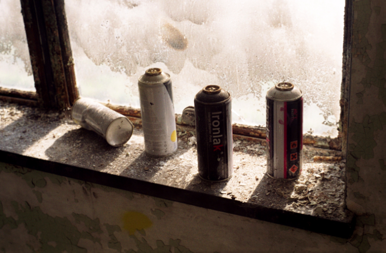 film photograph abandoned junk rubbish spraypaint cans