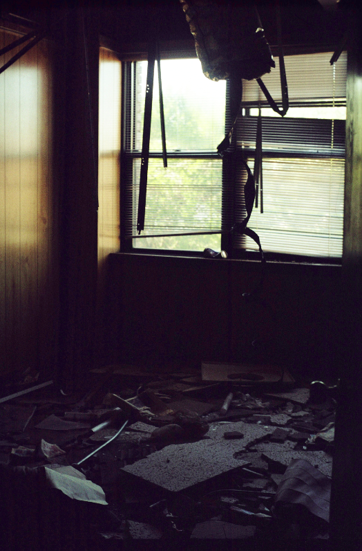 film photograph dark shadows chiaroscuro abandoned building trash debris
