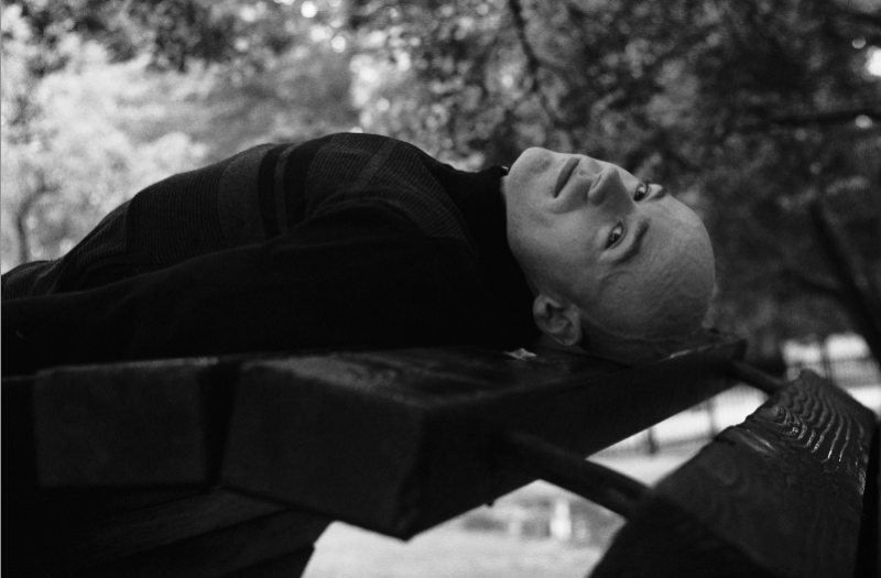 film photograph portrait black white lying back man