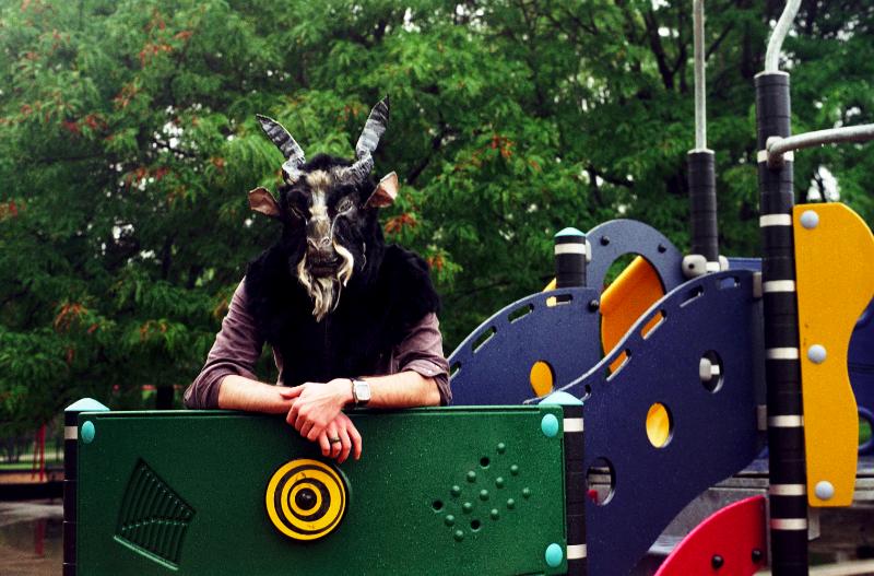 film photograph portrait playground man goat mask creepy