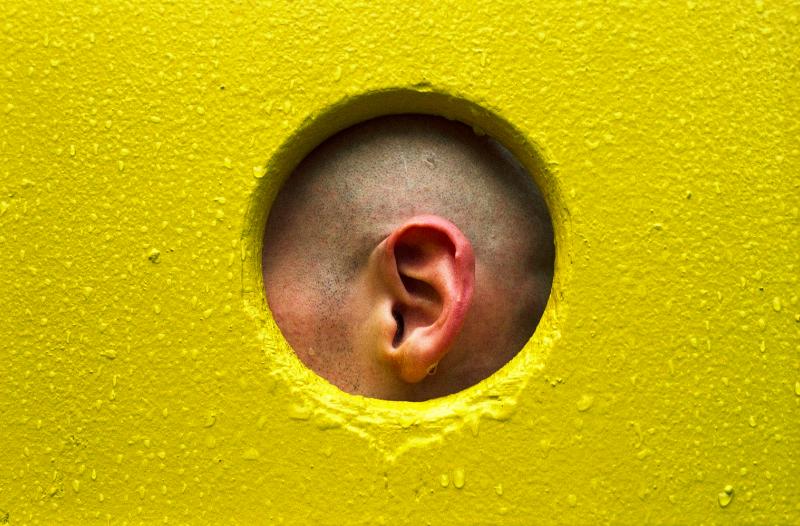 film photograph portrait playground man yellow rain water droplets ear framed hole