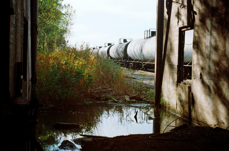 abandoned building urbex factory train tracks puddle water reflection