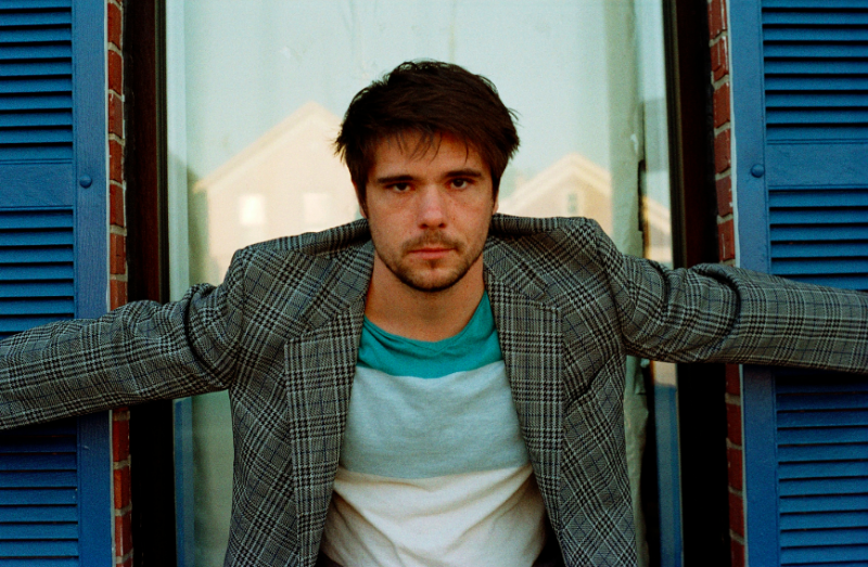 portrait film young man jacket pensive blue shutters